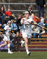 Boston College midfielder Mikaela Rix (17) brings the ball forward. .University of Maryland (black) defeated Boston College (white), 13-5, on the Newton Campus Lacrosse Field at Boston College, on March 16, 2013.