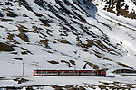 Train traveling through the alps heading for Realp close to the Furkapass, Oberwald, Switzerland.