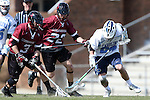 14 February 2015: UMass's Ryan Izzo (3) and North Carolina's Stephen Kelly (24) challenge for a loose ball as UMass's Tyler Weeks (22) chases the play. The University of North Carolina Tar Heels hosted the University of Massachusetts Minutemen in a 2015 NCAA Division I Men's Lacrosse match. UNC won the game 20-8.