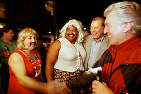 """Former Green Bay Packers guard Jerry Kramer and former Los Angeles Ram Claude Crabbe meet the Bud Light """"girls"""" in the French Quarter prior to Super Bowl XXXI in January, 1997."""