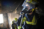 Firefighters practice drills at NSW fire department's Alexandria training depot in Sydney NSW.