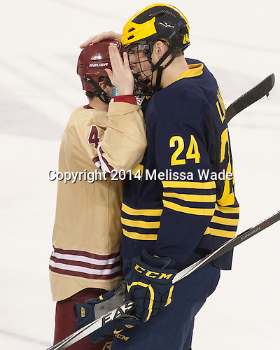 Teddy Doherty (BC - 4), Kevin Lohan (Michigan - 24) - The Boston College Eagles defeated the visiting University of Michigan Wolverines 5-1 (EN) on Saturday, December 13, 2014, at Kelley Rink in Conte Forum in Chestnut Hill, Massachusetts.