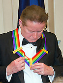 Don Henley of the rock band &quot;The Eagles,&quot; one of the five recipients of the 39th Annual Kennedy Center Honors adjusts his medal as he prepares to pose for a group photo following a dinner hosted by United States Secretary of State John F. Kerry in their honor at the U.S. Department of State in Washington, D.C. on Saturday, December 3, 2016.  The 2016 honorees are: Argentine pianist Martha Argerich; rock band the Eagles; screen and stage actor Al Pacino; gospel and blues singer Mavis Staples; and musician James Taylor.<br /> Credit: Ron Sachs / Pool via CNP