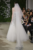 Model walks runway in a Rachel wedding dresses by Carolina Herrera, for the Carolina Herrera Bridal Spring 2012 runway show.