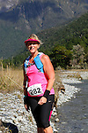 NELSON LAKES, NEW ZEALAND - APRIL 18:  Lisa Press crosses the Travers River during the 2015 Alpine Lodge Loop The Lake trail run at Lake Rotoiti on April 18 16, 2015 in Nelson, New Zealand. (Photo by Marc Palmano/Shuttersport Limited)