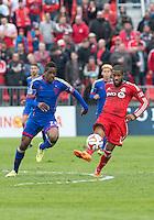 Toronto, Ontario - April 12, 2014: Colorado Rapids forward Deshorn Brown #26 and Toronto FC defender Jeremy Hall #25 in action during the 2nd half in a game between the Colorado Rapids and Toronto FC at BMO Field in Toronto.<br /> Colorado Rapids won 1-0.