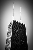 Black and white Chicago John Hancock Center building in downtown Chicago. Hancock Building is one of Chicago's most famous attractions. Photo is high resolution, and was taken in may 2010.