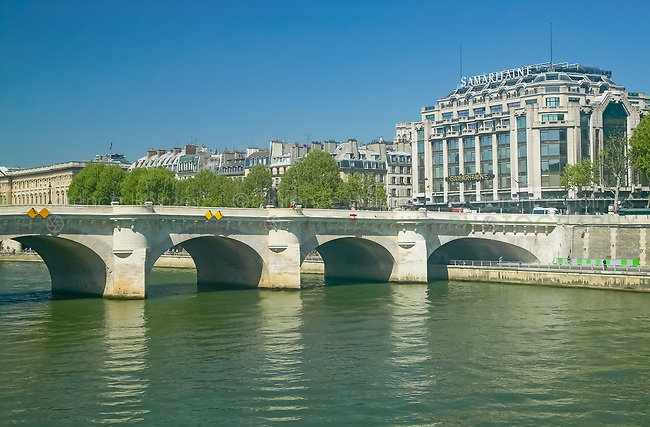 Pont Neuf bridging the Seine river and the Samaritaine department store, Paris France