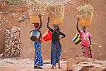 Women carrying baskets of millet, Mopti Region, Mali