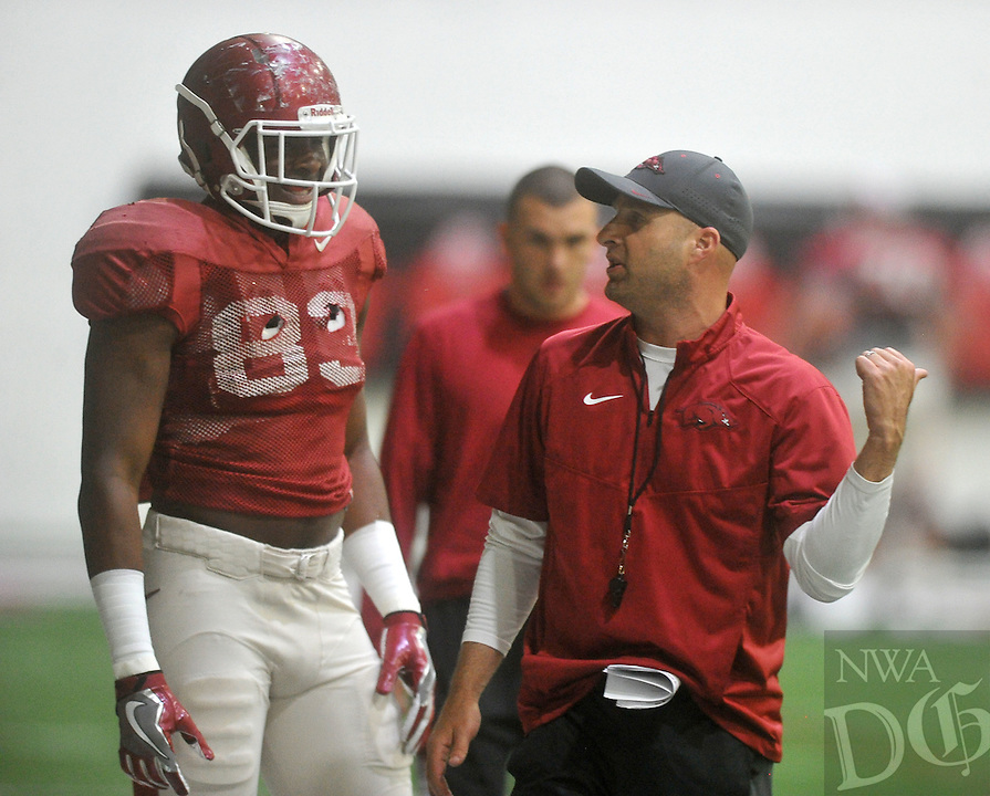 NWA Democrat-Gazette/MICHAEL WOODS &bull; @NWAMICHAELW<br /> University of Arkansas assistant coach Barry Lunney Jr. works with tight end Jeremy Sprinkle (83) during practice Tuesday, April 5, 2016 in Fayetteville.