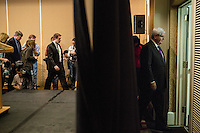 Newt Gingrich exits after a news conference announcing he is suspending his campaign for the Republican nomination for president on Wednesday, May 2, 2012 in Arlington, VA.
