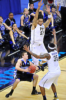 The Panthers plays tough defense on Bulldogs' Matt Dickey. Pittsburgh defeated UNC-Asheville 74-51 during the NCAA tournament at the Verizon Center in Washington, D.C. on Thursday, March 17, 2011. Alan P. Santos/DC Sports Box
