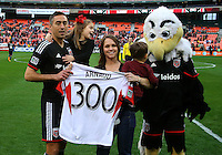 WASHINGTON, D.C - April 05 2014: D.C. United honored Davy Arnaud  for his three-hundredth MLS game before the D.C. United vs the New England Revolution i MLS match at RFK Stadium, in Washington D.C. United won 2-0.