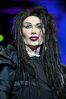 Pete Burns of Dead or Alive<br /> Performing at the PWL Hit Factory Live, o2 Arena, London, England, UK, <br /> 21st December 2012.<br /> music live on stage concert gig portrait headshot  black dress green contact lenses make-up pearl necklace shoulder pads <br /> CAP/MAR<br /> &copy; Martin Harris/Capital Pictures /MediaPunch ***NORTH AND SOUTH AMERICAS ONLY*** /MediaPunch ***NORTH AND SOUTH AMERICAS ONLY***