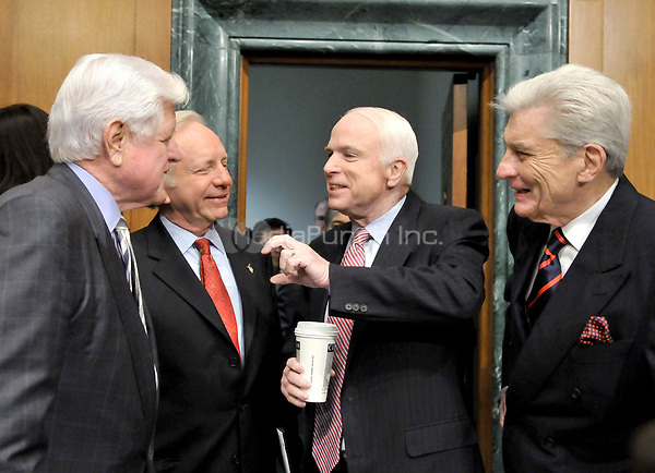 "Washington, DC - April 8, 2008 -- From left to right: United States Senators Edward M. ""Ted"" Kennedy, (Democrat of Massachusetts); Joseph I. Lieberman (Independent Democrat of Connecticut), John McCain (Republican of Arizona); and John Warner (Republican of Virginia) share a conversation prior to hearing the testimony of General David Petraeus and Ambassador Ryan Crocker before the United States Senate Armed Services Committee on the situation and progress in Iraq in Washington, D.C. on Tuesday, April 8, 2008..Credit: Ron Sachs / CNP/MediaPunch"