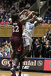 15 February 2012: Duke's Chelsea Gray (12) is fouled by Virginia Tech's Porschia Hadley (22). The Duke University Blue Devils defeated the Virginia Tech Hokies 67-45 at Cameron Indoor Stadium in Durham, North Carolina in an NCAA Division I Women's basketball game.