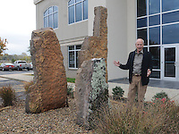 NWA Democrat-Gazette/FLIP PUTTHOFF <br /> Attorney and art aficianado Frank Bailey shows a stone sculpture at the entrance of the Bailey &amp; Oliver law office.