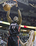 Miami Heats' Shaquille O'Neal (33) dunks the ball against the  Seattle Supersonics in the second quarter at Key Arena in Seattle, Washington  on Friday, 13 March 2005. Trying to defend O'neal is Sonics' Vitaly Potapenko.  Jim Bryant Photo. &copy;2010. All Rights Reserved.