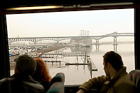 12 March 2006 - New Jersey, USA - Participants in a bus tour of locations featured in the hit television mob show The Sopranos look out at the Pulaski Skyway (background), in New Jersey, USA, 12 March 2006.