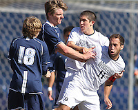 Jose Colchao #11 of Georgetwn University is shoved by Dylan Renna #9 of Villanova University during a Big East match at North Kehoe Field, Georgetown University on October16 2010 in Washington D.C. Georgetown won 3-1.