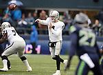 Oakland Raiders quarterback Derek Carr (4) passes against the Seattle Seahawks at CenturyLink Field in Seattle, Washington on November 2, 2014. The Seahawks beat the Raiders 30-24 in Seattle. ©2014. Jim Bryant Photo.