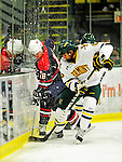 29 December 2010: University of Vermont Catamount forward Sebastian Stalberg, a Sophomore from Gothenburg, Sweden, checks Grant Gorczyca, a forward attending Lindenwood University during action against the 2011 U.S. Men's National University Team in an exhibition game at Gutterson Fieldhouse in Burlington, Vermont. The Catamounts defeated the National team 7-1. Mandatory Credit: Ed Wolfstein Photo