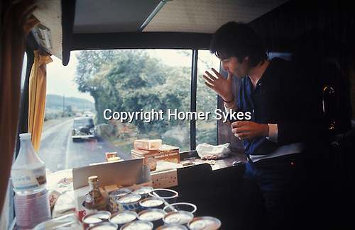 "Paul McCartney. 1970s Wings tour bus, his two Rolls Royce cars following. The photographs from this set were taken in 1975. I was on tour with them for a children's ""Fact Book"". This book was called, The Facts about a Pop Group Featuring Wings. Introduced by Paul McCartney, published by G.Whizzard. They had recently recorded albums, Wildlife, Red Rose Speedway, Band on the Run and Venus and Mars. I believe it was the English leg of Wings Over the World tour. But as I recall they were promoting,  Band on the Run and Venus and Mars in particular."