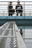 Two employees inspect the tanks at Suez's Sino-French Drinking Water Treatment Plant, Chongqing, China