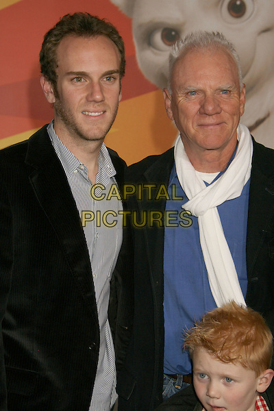 """CHARLIE McDOWELL & MALCOLM McDOWELL .""""Bolt"""" Disney World Premiere held at the El Capitan Theatre, Hollywood, California, USA..November 17th, 2008.half length black jacket white scarf blue  father son dad .CAP/ADM/MJ.©Michael Jade/AdMedia/Capital Pictures."""