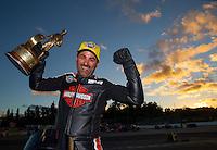 Nov 15, 2015; Pomona, CA, USA; NHRA pro stock motorcycle rider Eddie Krawiec celebrates after winning the Auto Club Finals at Auto Club Raceway at Pomona. Mandatory Credit: Mark J. Rebilas-USA TODAY Sports