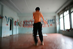 Lutfullo, 16, is break-dancing in Kokand