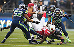 Seattle Seahawks Strong Safety Kam Chancellor (31) and defense end Red Bryant (79) upends Arizona Cardinals running back Rashard Mendenhall (28) during the first quarter at CenturyLink Field in Seattle, Washington on December 22, 2013.   The Cardinals beat the Seahawks 17-10. ©2013. Jim Bryant Photo. ALL RIGHTS RESERVED.