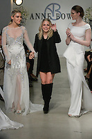 "Fashion designer Anne Bowen walks runway with models, at the close of her Anne Bowen Bridal Spring 2013 ""Coat of Arms"" collection fashion show, during Bridal Fashion Week New York April 2012."