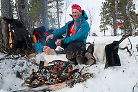 Saltoluokta Mountain Station, Jokkmokk, Lapland, Sweden, March 2013. Dry your socks, gloves, mittens and boots, whenever you have a fire, because the will freeze if you don't. Arctic survival training and winter bushcraft  in the frigid mountains of the Stora Sjofallet National Park and Sarek National Park with mountain guide Claes Jorgen Pohl.  Photo by Frits Meyst/Adventure4ever.com
