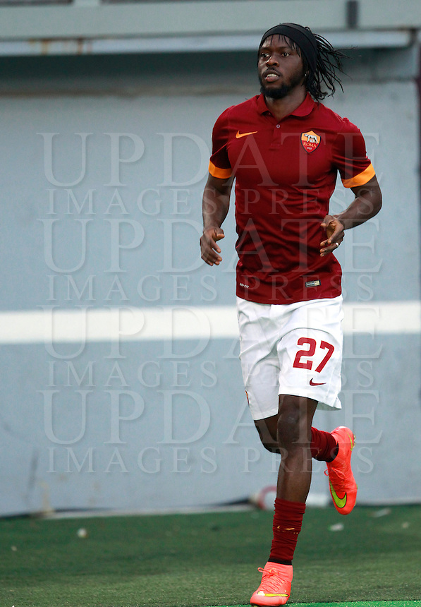 Calcio, amichevole Roma vs Fenerbahce. Roma, stadio Olimpico, 19 agosto 2014.<br /> Roma forward Gervinho, of Ivory Coast, arrives for the team's presentation, prior to the friendly match between AS Roma and Fenerbahce at Rome's Olympic stadium, 19 August 2014.<br /> UPDATE IMAGES PRESS/Isabella Bonotto