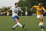 20 September 2009: Duke's Chelsea Canepa (22) crosses the ball past LSU's Brittany Lowe (12). The Duke University Blue Devils played the Louisiana State University Tigers to a 2-2 tie after overtime at Koskinen Stadium in Durham, North Carolina in an NCAA Division I Women's college soccer game.