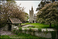BNPS.co.uk (01202 558833)<br /> Pic: GrahamHunt/BNPS<br /> <br /> Church in Melbury Abbas.<br /> <br /> A sleepy Dorset village is getting jammed up to 18 times a week with big lorries after highways officials deliberately directed them to drive through it in a controversial traffic experiment.<br /> <br /> The 'unbelievable' strategy has brought havoc and misery to Melbury Abbas where villagers are getting used to the sight of a 30 tonne HGV blocking the narrow main road.<br /> <br /> Cars heading through the pretty hamlet face delays of up to an hour whenever a hapless trucker attempts to pass another large vehicle using the C13.<br /> <br /> Kerbs, grass verges and a water hydrant have been badly damaged by truckers mounting them to create space to squeeze though, while one HGV came within just 2ins of colliding with a Grade II listed property on one occasion.
