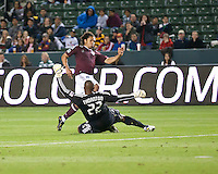 Colorado Rapids forward Quincy Amarikwa (12) avoids Chivas USA goalie Zach Thornton (22) to go on and score the games only goal during the first half of the game between Chivas USA and Colorado Rapids at the Home Depot Center in Carson, CA, on March 26, 2011. Final score Chivas USA 0, Colorado Rapids 1.