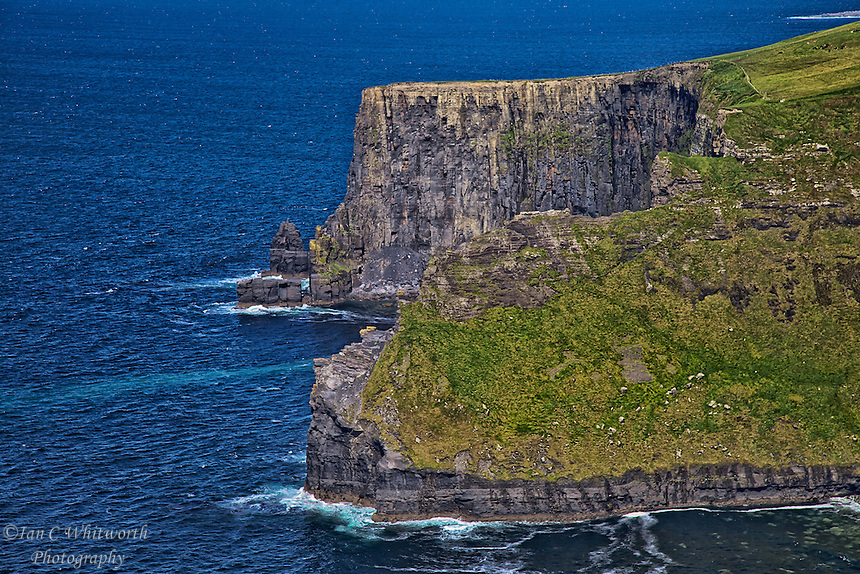 Looking north up the coast at the Cliffs of Moher in Ireland.
