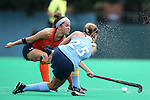12 September 2014: North Carolina's Abby Frey (25) has a pass blocked by Syracuse's Lauren Brooks (behind). The University of North Carolina Tar Heels hosted the Syracuse University Orange at Francis E. Henry Stadium in Chapel Hill, North Carolina in a 2014 NCAA Division I Field Hockey match. UNC won the game 3-0.