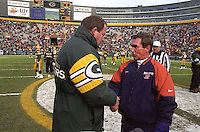 Green Bay Packers Coach Mike Holmgren and Denver Broncos Coach Mike Shanahan say hello prior to the game at Lambeau Field.
