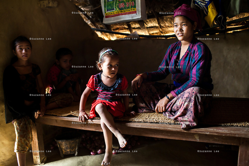 Tulasa Khadka, 14, who got married when she was 13 and gave birth to a stillborn baby weighing less than 1kg a week ago, rests at home with her husband's extended family in the remote village of Dungi Khola, near Chhinchu, Surkhet district, Western Nepal, on 1st July 2012. Tulasa eloped one year ago and didn't use contraceptives. She walks through the hills to the nearest hospital and she went into labour while on her way there for a checkup at almost full term. In Surkhet, Save the Children partners with Safer Society, a local NGO which advocates for child rights and against child marriage. Photo by Suzanne Lee for Save The Children UK