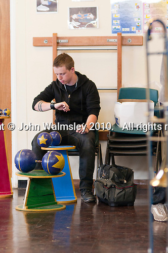 Checking the time.  Students from Rose Bruford College set up their equipment, scenery and props before performing at a state Infant School.