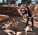 PE00129-00...WASHINGTON - Ruth Spring splitting wood. (MR #S12)