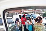 Rapper Waka Flocka is approached by fans in a parking lot in Atlanta, Georgia August 17, 2010.