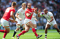 Jamie Roberts of Wales passes the ball. Old Mutual Wealth Cup International match between England and Wales on May 29, 2016 at Twickenham Stadium in London, England. Photo by: Patrick Khachfe / Onside Images