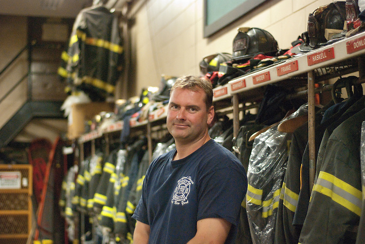 UNITED STATES - Sept 1 : Ken Haskell, an advisor to Rep. Peter King (R-N.Y.) stands in front of the fire truck at Ladder 175 in Brooklyn, where he is also a firefighter. (Photo By Emily Heil )