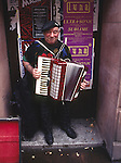 An accordian player performs for passersby in downtown Glasgow.