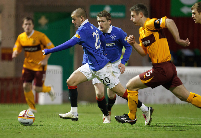 Vladimir Weiss propels himself through the Motherwell defence to score goal no 3 for Rangers