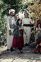 Iraq 1968 <br /> In a village, peshmergas and children   <br /> Irak 1968  <br /> Dans un village des enfants avec des peshmergas